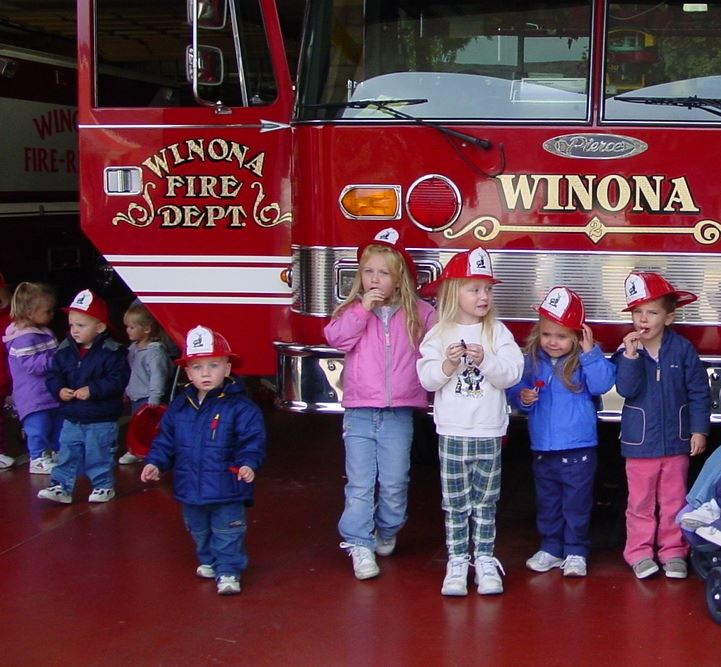 Group of small children in front of a fire truck
